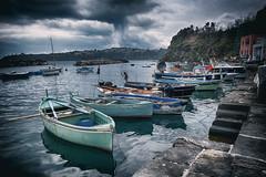 cloudy day in Procida (FedeSK8) Tags: procida federicoscotto fujifilmxm1 italia italy campaniafelix corricella mediterraneansea drama sky mare napoli naples boats porticciolo fedesk8