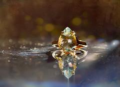 Golden Backlight ... (MargoLuc) Tags: golden backlight macromondays theme backlit bokeh ring gem goshenite macro glow sunlight jewel gold reflection