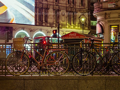 """Bicycles Locked At Piccadilly Circus Over Night - London, England, 2016 (Photographie Alexi """"Alvin"""" Dagher Photography) Tags: alexidagher 2016 advertisement arches architecture attraction bicycles billboard britain british bus circle city cityofwestminster commercial doubledeckerbus end england english europe famous giantscreen guard illuminated illumination interest intersection junction landmark ledge london longexposure meeting midnight multicolor neon night nopeople old outdoor piccadillycircus place rails red road scene sign square stairs street streetlights summer theatreland ticketssale tourism tourist traffic transit travel tubestationentrance uk underground urban welllit west"""