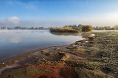 Misty Morning at the Lake (Mirek Pruchnicki) Tags: lake morning misty fog autumn colors sky bluesky beach sand samyang14f28 radymno poland subcarpathian