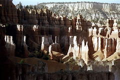 34-698 (ndpa / s. lundeen, archivist) Tags: nick dewolf nickdewolf color photographbynickdewolf 1970s 1973 film 35mm 34 reel34 utah southernutah southwesternunitedstates nationalpark brycecanyon brycecanyonnationalpark spires rock rocks rocky formation landscape terrain formations peaks outcropping outcroppings erosion stratification 1972