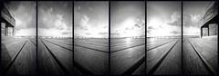 Hastings Pier (DanRSmith) Tags: bw blackandwhite monochrome pinhole pinholecamera ondu ondupinhole ilfordpanf50 rodinal hastings hastingspier pier lines clouds