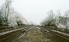 tracks in winter (september.) Tags: 35mm film canonae1 canonfd canonfd35mmf2ssc kodakportra400 washingtondc northeast brookland cua metro station train tracks wmta winter snow