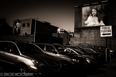 Nursing Posters on the street ([nixon]) Tags: city parking contrast light fujifilm fujifilmxpro2 23mmf2 building poster woman child breastfeeding infant walls lady sky details golden air art prints photo photography blackwhite car street