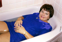 Swimming with Jewelry, 18 (clarkfred33) Tags: tub bathtub wetdress birthday celebrate wetadventure bluedress 2000 goldjewelry swim wade spirit mood ttd trashthedress wetfun pantyhose wetlook