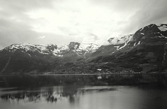 Hardangerfjorden (Black & white) (Lise-Marie Photography) Tags: ocean summer sky blackandwhite snow mountains norway clouds canon landscape bright farmland fjord hordaland hardanger hardangerfjord monochorme canon60d