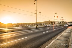 Golden Mile (juergenlehmann) Tags: city sunset sun architecture architecturephotography cityscape traffic bridge sony alpha sonyalpha austria linz architektur danube brcke sonne sonnenuntergang stadt donau verkehr sterreich urfahr obersterreich upperaustria nibelungenbrcke lensflares a37 sal1680z pstlingberg juergenlehmann jrgenlehmann photography travel travelphotography yellow gelb street strase photoshop lightroom