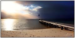 Shine (juliewilliams11) Tags: photoborder outdoor sea foreshore shore water jetty birds cloud sunset footprints dark contrast