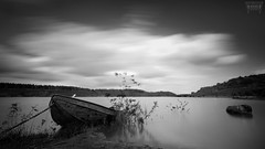 F L O A T I N G (Vanwetswinkel Vincent) Tags: nature bw landscape lake boat abandoned rust dream long exposure lee big stopper sony a7s clouds sky