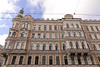 Old apartment building front view in St. Petersburg, Russia (phuong.sg@gmail.com) Tags: 20th antique apartment architecture brick building century closeup crack crumble day different dirty downpipe downspout drain exterior facade frame front fronton gable grate group historic horizontal iron ledge nobody old ornamental outdoors pattern pediment petersburg plaster platband red row russia saint several structure symmetry texture urban wall window wrought