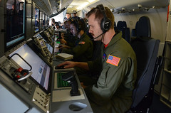 Sailors rehearse operations aboard a P-8A Poseidon maritime patrol aircraft in a training mission.