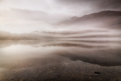 Ysbryd y Llyn / Spirit of the Lake (Ffotograffiaeth Dylan Arnold Photography) Tags: landscape outdoor lake water mist trees sky rock boatshed boathouse moody atmospheric serene tranquil still silent ethereal magical fog mountain llyndinas eryri snowdonia relection symmetry symmetrical clouds contrast