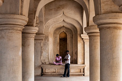 Couple. Tanjore, India (Marji Lang Photography) Tags: travel two people woman india man love monument architecture composition temple happy couple mood indian memories streetphotography documentary atmosphere arches shy location lovers architectural together moment lovely arcades thanjavur hindu youngcouple photosession tamil atmospheric tamilnadu alcove mandir coupleshot prewedding ambiance tanjore environmentalportrait travelphotography brihadishwara republicofindia peoplephotography alcoves indianarchitecture beautifulplace indianlife indianpeople couplepictures ef247028l indiansubcontinent indianmood coupleshooting  indiancouple canoneos5dmarkii bhrat tanjavr travelanddocumentaryphotography  loveinindia marjilang indianatmosphere