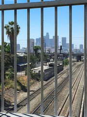 Railroad tracks leading to downtown Los Angeles from Griffin Avenue bridge (Matt McGrath Photography) Tags: california railroad bicycle skyline fence losangeles unitedstates tracks cannondale downtownlosangeles labybike