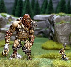 A giant has come down from the Misty Mountains and is about to have his toenails cut by a suicidal barbarian! (torq42) Tags: miniatures fantasy lordoftherings wargame 15mm tabletop 18mm