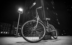 Bike at night (dansshots) Tags: nyc newyorkcity nightphotography blackandwhite bicycle solitude nightshot streetscene schwinn bnw blackandwhitephotography cityscene newyorkatnight inthedark inthelight schwinnbicycle photographyatnight nikond3 dansshots