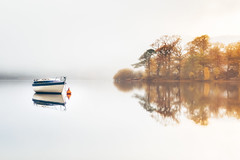 Solitude (Vemsteroo) Tags: morning travel autumn trees mist lake reflection nature beautiful fog sunrise canon outdoors dawn boat still soft derwent exploring lakedistrict cumbria 5d serene derwentwater keswick tranquil neutral mkiii 2470mm visitengland leefilters visitbritain lovegreatbritain