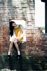 Nixie (I C E I N N) Tags: sonnartfe1855 carlzeiss e fe sony outdoor photoshoot asian girl moody gaze people sit portrait white yellow dress shirt socks black school shoes brickwall bricks wall sunlight shadow sonya7ii ilce7m2 emount femount 55mm f18  pinghsuan  nixie