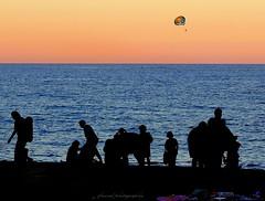 Night is falling on Barceloneta beach, Barcelona (jackfre 2) Tags: catalunya spain barcelona barceloneta barcelonetabeach beach bathers sea restaurants diners parachute
