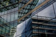 puzzling reflections (bernd obervossbeck) Tags: struktur structure architektu architecture berlin fassade reflection reflektion spiegelung glas glass fenster window windows stahl steel hochhau tower geometrischeformen pattern muster