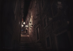 she never came out (cherryspicks (off for a while)) Tags: street alley night person steps dubrovnik croatia architecture mediterranean windows doors stonework light travel historic city urban noire