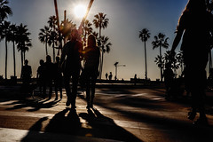 Venice Beach. (drpeterrath) Tags: canon eos5dsr dsr color california losangeles lacp la naturallight man woman couple walking sunlight silhouette blue bluesky sky motion movement moody shadow street streetphotography