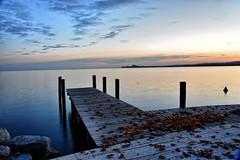 Relax (giannipiras555) Tags: pontile foglie autunno orizzonte landscape tramonto scogli