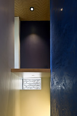 Wall and window detail above the stairs. The blue wall is polished plaster