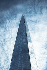 Shard Vortex (Skuggzi) Tags: city uk blue england sky urban building london glass vertical architecture modern clouds facade skyscraper triangle pyramid unitedkingdom britain outdoor dramatic lookingup lookup highrise scifi hightech iconic futuristic southwark neofuturism