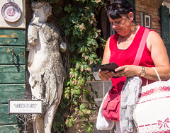 Do Not Distract (UrbanphotoZ) Tags: venice italy woman statue store ivy plate weathered armless tablet venezia shoppingbag torcello veneto arredidarte