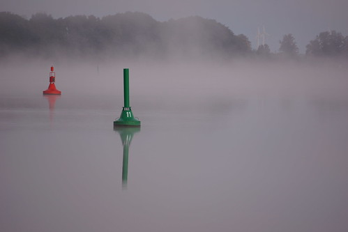 Two buoys in mist