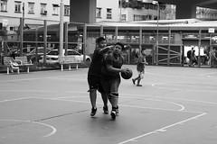 One-on-one battle (leo shy) Tags: city blackandwhite monochrome playground basketball children hongkong battle dslr childs yaumatei oneonone canon70d