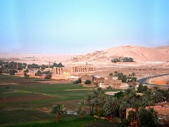 Ramesseum of Ramesses II on the West Bank of the Nile in Luxor (Travel to Eat) Tags: balloons dawn morninglight earlymorning egypt luxor hotairballoons nileriver lushgreenfields