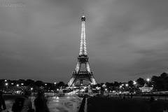 Der Eiffelturm (rouvenbe) Tags: city trip travel light blackandwhite black paris france skyline bulb night canon geotagged la frankreich cityscape tour outdoor live roadtrip eiffel german architektur turm eiffelturm defense
