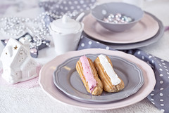 French confectionery, pink and white Eclair on gray dish (♥Oxygen♥) Tags: life christmas pink food house holiday cake giant studio french dessert lunch high still close view dish angle sweet bokeh shots chocolate pastel gray cream puff pudding selection gourmet textile snack pastry tender eclair indulgence straberry plated eclaire palte