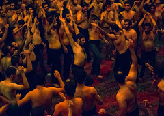 iranian shiite muslim mourners from the mad of hussein community chanting and self-flagellating during muharram, Isfahan Province, Kashan, Iran (Eric Lafforgue) Tags: shirtless people men history festival horizontal religious sadness togetherness mourning dancing iran islam traditional religion crowd ceremony middleeast culture celebration holy indoors beat males historical shia ritual muharram ashura muslims celebrate sorrow kashan hussein adultsonly trance islamic beating iman shiite ashoura hussain hoessein menonly commemorate persiangulfstates  onlymen selfflagellation  16255 husayn colourimage hussayn  iro isfahanprovince shiism  westernasia  selfflagellating madofhussein