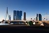 Skyscraper in Rotterdam (Wolfgang-Weber) Tags: netherland rotterdam tower three oma rem koolhaas hotel harbour district erasmus bridge skyline sky heaven blue morning sun wilhelminapier canon eos 5d mark iii ef24105mm f4l is usm