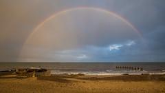 sunset rainbow ( EXPLORED) (waynedavey67) Tags: canon 6d 1635mmlf4 lowestoft suffolk beach rainbow sunset landscape seascape sky weather colours rain clouds sand rocks gryons waves explore