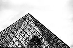 Tip of Pei's Pyramid (EmperorNorton47) Tags: paris iledefrance france photo analog film nikonn8008 nikonn801 fomapan100 autumn fall blackandwhite thelouvre pyramid architecture impei