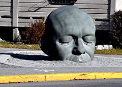 Giant Head (Jane Olsen ( Chardonnay)) Tags: sculpture art road sidewalk yellowline outdoors