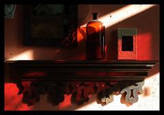 The Medicine Bottle (Poocher7) Tags: woodenshelf pinkwalls decorative pretty lovely warm brownbottle medicinebottle pictures shadows light diffusedlight indoor orange