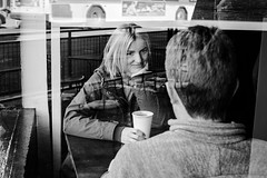 coffee date (jeff_tidwell) Tags: coffee street streetphotography streetphoto candid window reflection woman smile couple date
