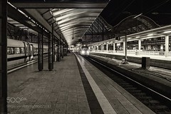 Departure -<>- Arrival (DRoofing163) Tags: line travel night light train transportation roof railway black white still life loneliness hall holiday work rail station canopy roofing tracks business passenger passengers frankfurt frankfurtmain arrival departure staition