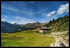 Meanwhile in the mountains ... (Facciamo2Scatti) Tags: sky verde green clouds trekking nuvole blu cielo sentiero azzurro prato montagna paesaggio altoadige baita alpino camminare muretto recinzione recinto altitudine facciamo2scatti alessiobrinati
