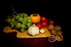 Italian food (frens_deby) Tags: stilllife food fruits vegetables tomatoes grapes chopping garlic tamron uva frutta pomodori cibo aglio verdura tagliere tamron247528 nikond610 persimmonapple melacachi