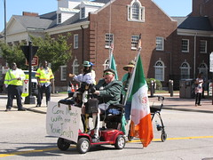 Come March with me if You're Irish (Gerry Dincher) Tags: fayetteville cumberlandcounty northcarolina marketsquare haystreet personstreet parade internationalfolkfestival multicultural irish rascal mobility monkey ape elderly flagofireland