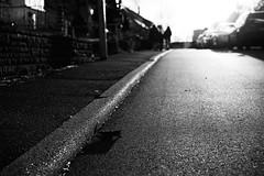 Glittering street (stefankamert) Tags: stefankamert street glittering glitter road highcontrast people dof bw sw baw black blackandwhite blackwhite noir noiretblanc sony a7 sonya7 ilce7 fullframe mirrorless sel55f18z fe55mmf18za
