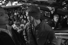 A last glimpse (Bjarne Erick) Tags: young man crowded trainstation lookingback platform escalator fuji x100t wcl 19mm 28mm