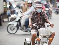 Man on motorbike stares at paparazzi (ffagency.com) Tags: paparazzi motorbike man phnompenh cambodia asia travel outdoor