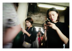 somewhere else (handheld-films) Tags: hongkong people commuters closeup distracted absorbed phones travellers commute commuting communications starferry passengers asia travel